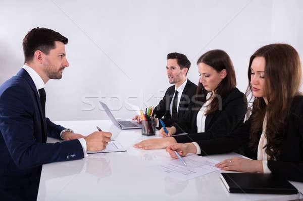 Csoport üzletemberek megbeszél papírmunka fiatal megbeszélés Stock fotó © AndreyPopov