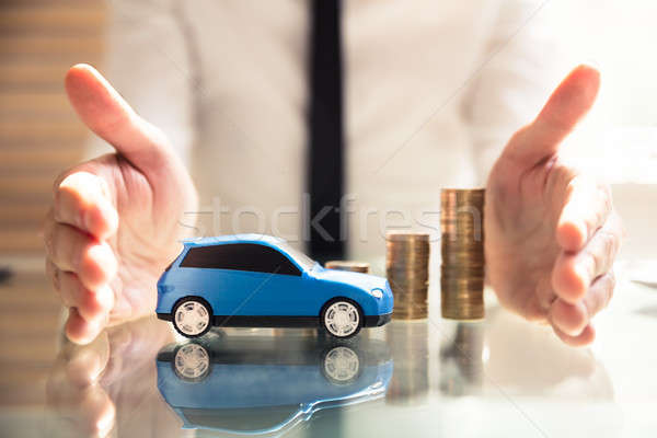 Person Protecting Increasing Stacked Coins And Car Stock photo © AndreyPopov