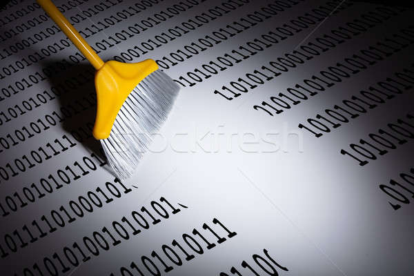 Close-up Of Broom Sweeping Digits Stock photo © AndreyPopov