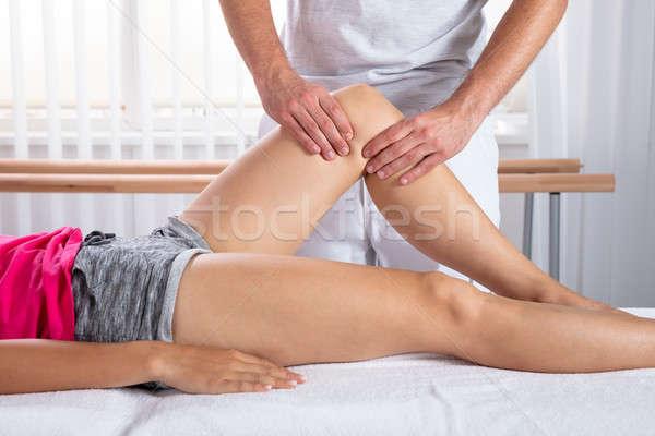 Therapeut Knie Massage Frau männlich Mann Stock foto © AndreyPopov