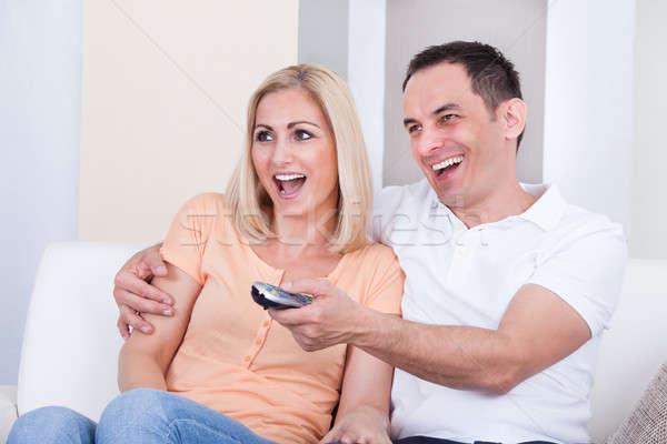 Pár tart távoli tv nézés boldog család Stock fotó © AndreyPopov