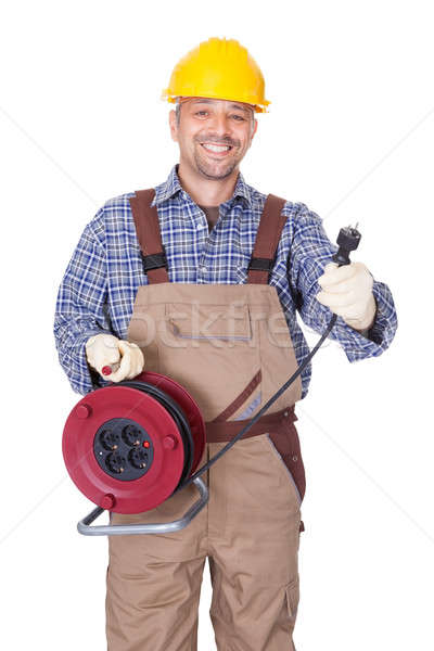 Happy Electrician Holding Wire Plug Stock photo © AndreyPopov
