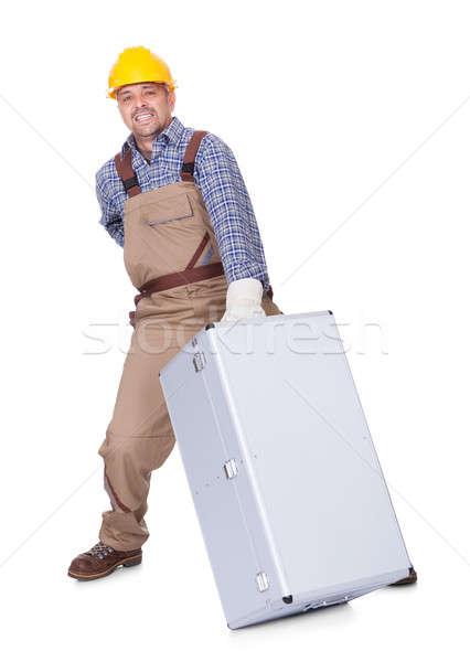 Man With Back Pain Lifting Metal Box Stock photo © AndreyPopov
