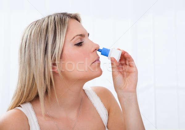 Woman using nasal spray Stock photo © AndreyPopov