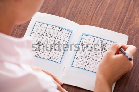 Woman Solving Sudoku Stock photo © AndreyPopov