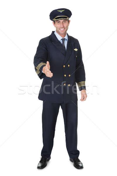 Portret pilota odizolowany biały szczęśliwy handshake Zdjęcia stock © AndreyPopov