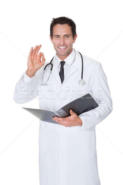 Portré barátságos orvos készít oké kézmozdulat Stock fotó © AndreyPopov