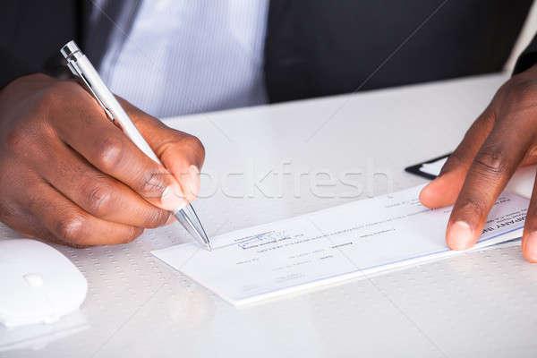 Menselijke hand schrijven cheque business kantoor Stockfoto © AndreyPopov