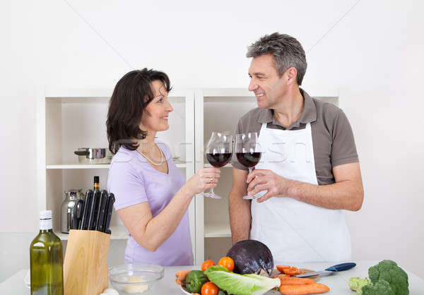 Senior couple cooking at home Stock photo © AndreyPopov
