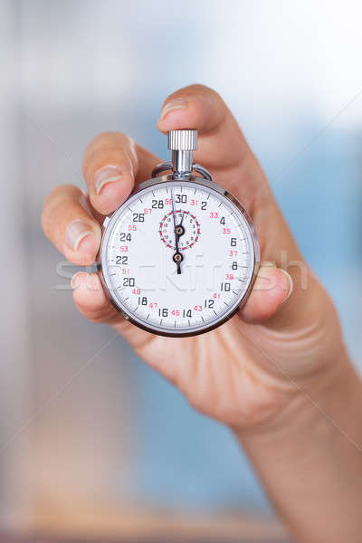 Cronômetro feminino mão negócio Foto stock © AndreyPopov