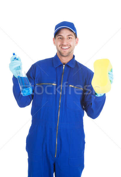 Servant Holding Cleaning Spray And Sponge Stock photo © AndreyPopov