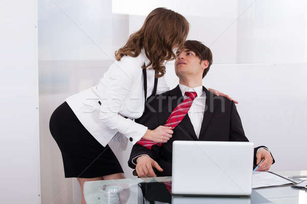 Sensuous Secretary Seducing Boss At Desk Stock photo © AndreyPopov