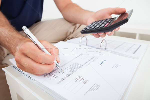Man Calculating Home Finances Stock photo © AndreyPopov