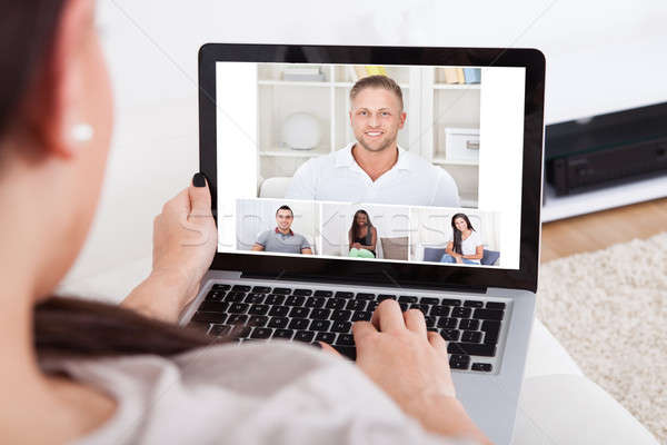 Young Woman Using Laptop For Videochatting Stock photo © AndreyPopov