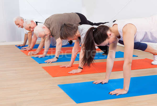 Trainer And Customers Doing Push Ups Stock photo © AndreyPopov