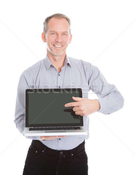 Businessman Pointing On Laptop Stock photo © AndreyPopov