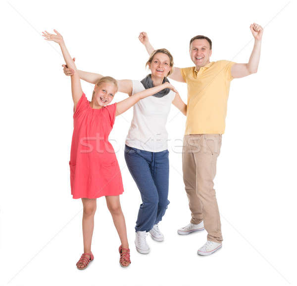 Excited Young Happy Family Jumping Stock photo © AndreyPopov
