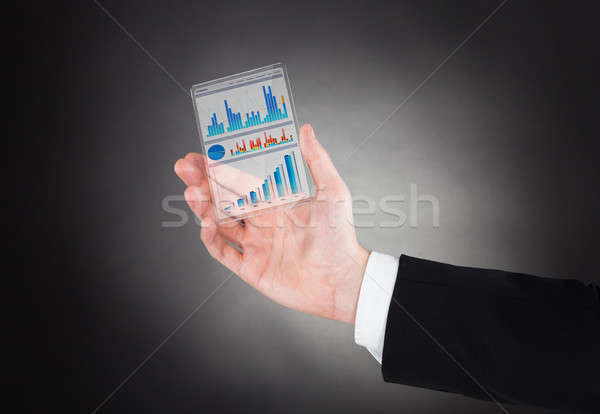 Businessman Showing Graphs On Modern Smartphone Stock photo © AndreyPopov