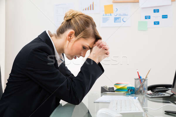 Upset Businesswoman In Office Stock photo © AndreyPopov