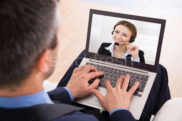 Businessman Video Chatting Stock photo © AndreyPopov