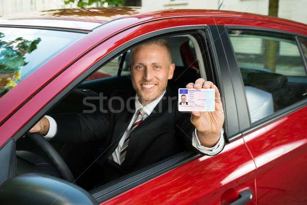 Işadamı sürücü lisans portre genç Stok fotoğraf © AndreyPopov