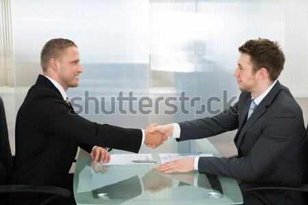 Dos empresario otro manos jóvenes feliz Foto stock © AndreyPopov