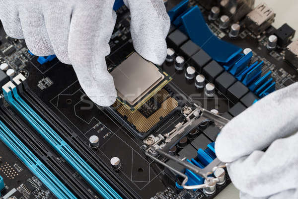 Person Installing Central Processor In Motherboard Stock photo © AndreyPopov