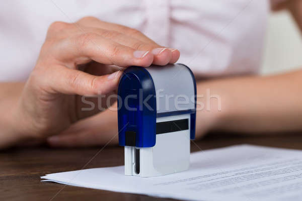 Person Hands Stamping Document Stock photo © AndreyPopov