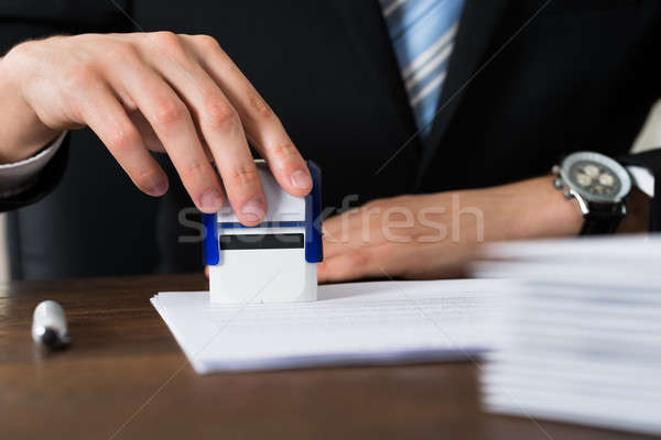 Businessman Stamping Contract Paper Stock photo © AndreyPopov