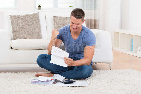 Man With Receipts And Calculator Stock photo © AndreyPopov