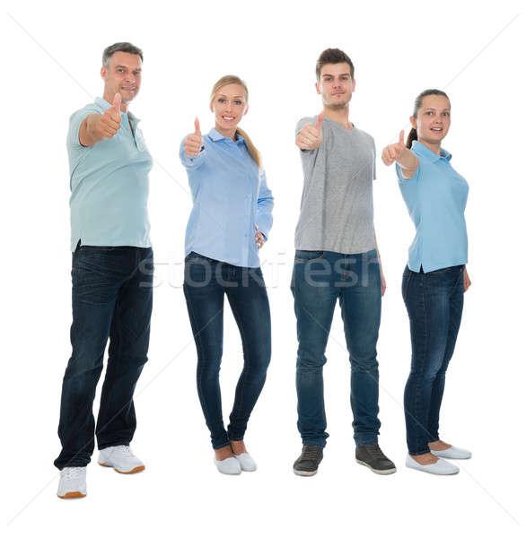 Pessoas felizes polegar para cima assinar grupo Foto stock © AndreyPopov