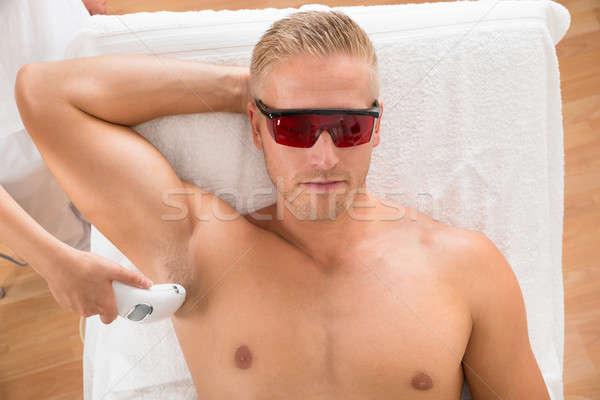 человека лазерного эпиляция лечение молодым человеком Сток-фото © AndreyPopov