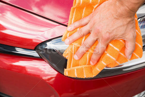 Male Worker Cleaning Car Headlight Stock photo © AndreyPopov