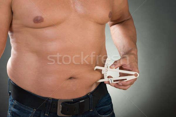 A torso nudo uomo stomaco grasso mano Foto d'archivio © AndreyPopov