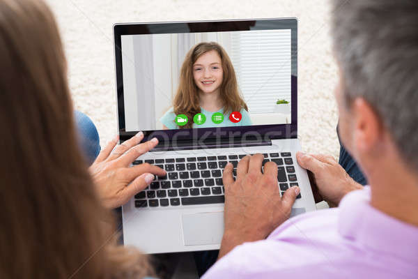 Couple Video Chatting On Laptop Stock photo © AndreyPopov