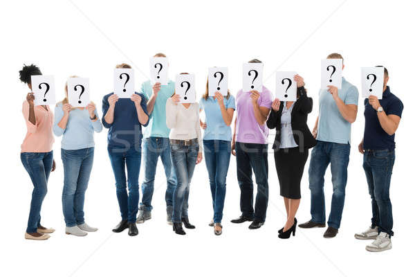 Creative Business Team Hiding Faces With Question Mark Signs Stock photo © AndreyPopov