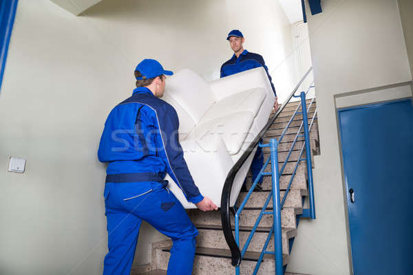 Movers Carrying Sofa On Steps Stock photo © AndreyPopov