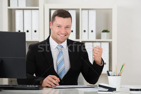 счастливым бизнесмен кулаком столе служба портрет Сток-фото © AndreyPopov