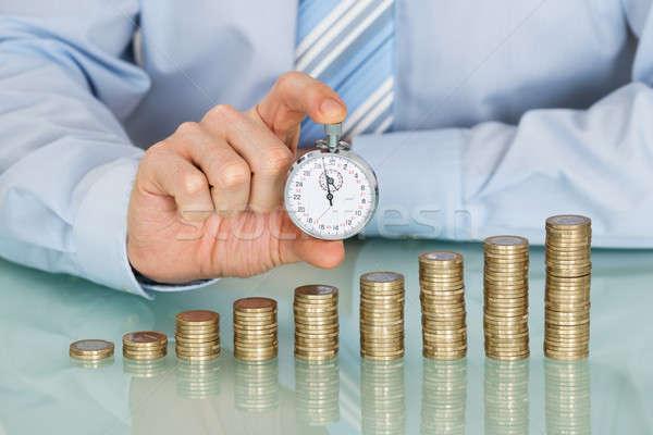 Empresario cronógrafo primer plano monedas Foto stock © AndreyPopov