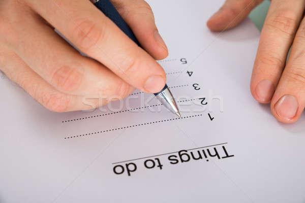 Personnes main écrit choses pour faire la liste Photo stock © AndreyPopov