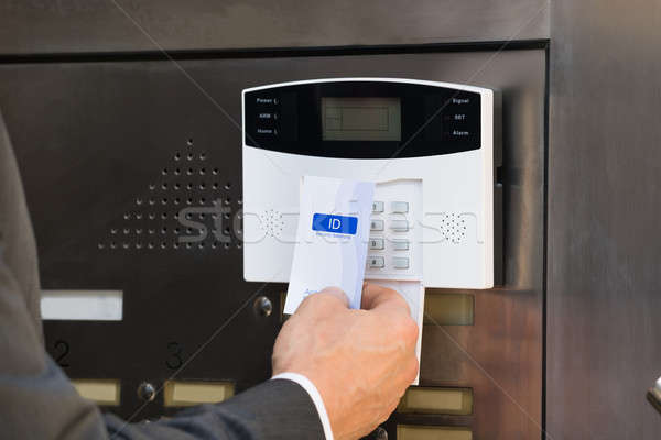 Close-up Of Businessperson Holding Keycard For Security System Stock photo © AndreyPopov