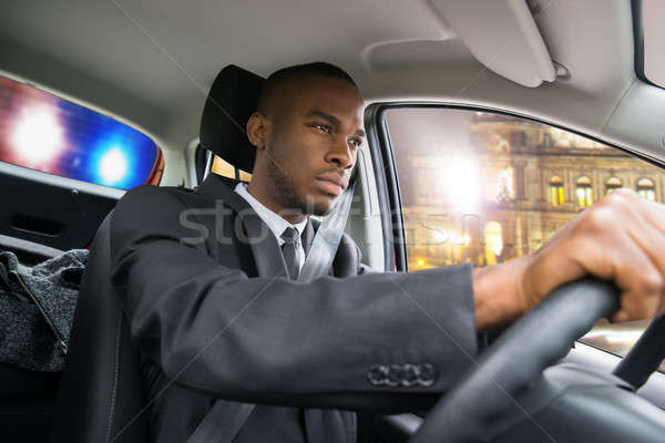 Businessman Chased By Police While Driving Car Stock photo © AndreyPopov