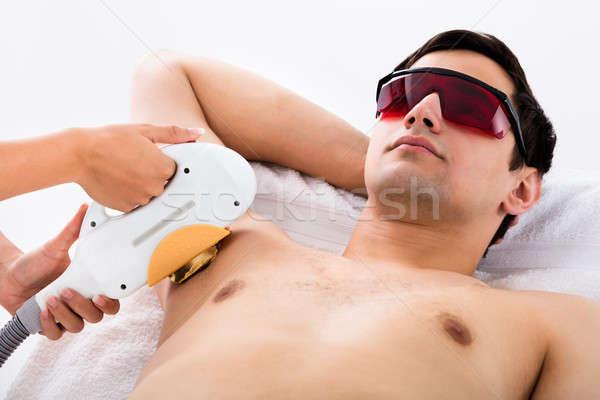Férfi lézer epiláció kezelés fiatalember szemüveg Stock fotó © AndreyPopov