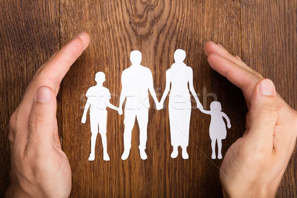 Person Hand Protecting Family Papercut Stock photo © AndreyPopov