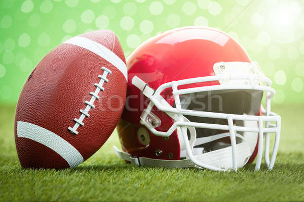 Rugby Helmet With Ball On Field Stock photo © AndreyPopov