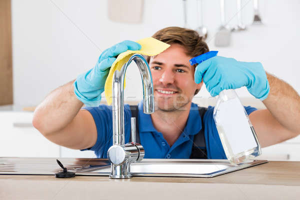 Male Washing Facet Stock photo © AndreyPopov