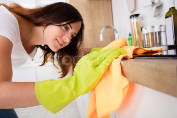 Close-up Of Woman Cleaning Induction Stove Stock photo © AndreyPopov