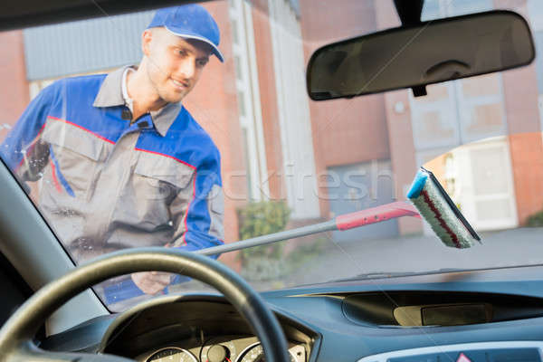 Man Washing Car Window With Mop Stock photo © AndreyPopov