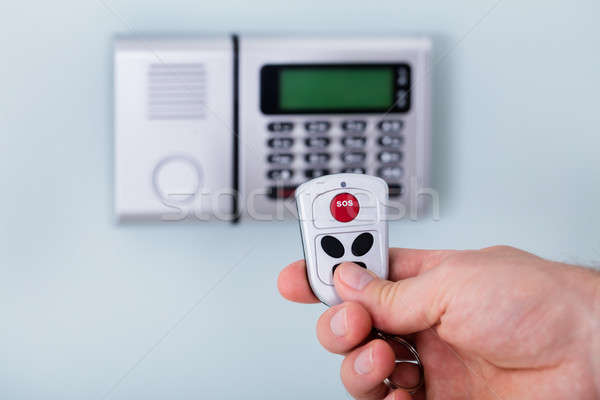 Person Hand Using Remote To Operate Security System Stock photo © AndreyPopov