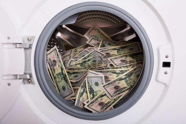 Soldi lavatrice primo piano sporca banca Foto d'archivio © AndreyPopov